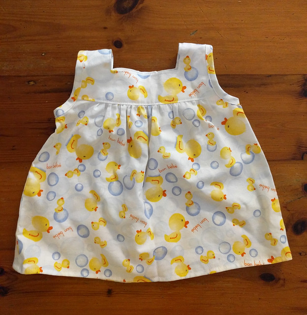 A baby dress in duck print.