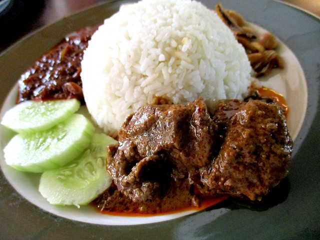 Colourful nasi lemak with beef curry