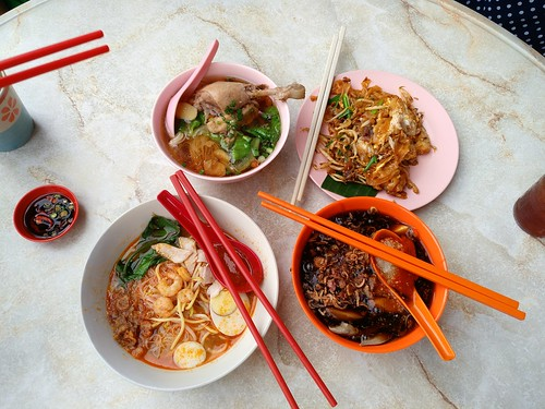 Clockwise from top right: tiger char koay teow, lor mee, Hokkien prawn mee, and some herbal chicken soup