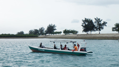 Boat of fishermen off Pulau Semakau (South)