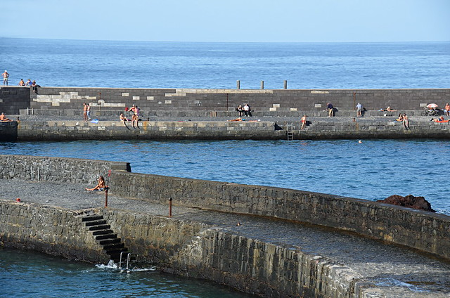 Sunbathers at the harbour, Puerto de la Cruz, Tenerife