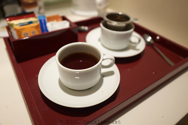 the carpet is new, but they still got the laquered trays with the cute 6oz tea cups