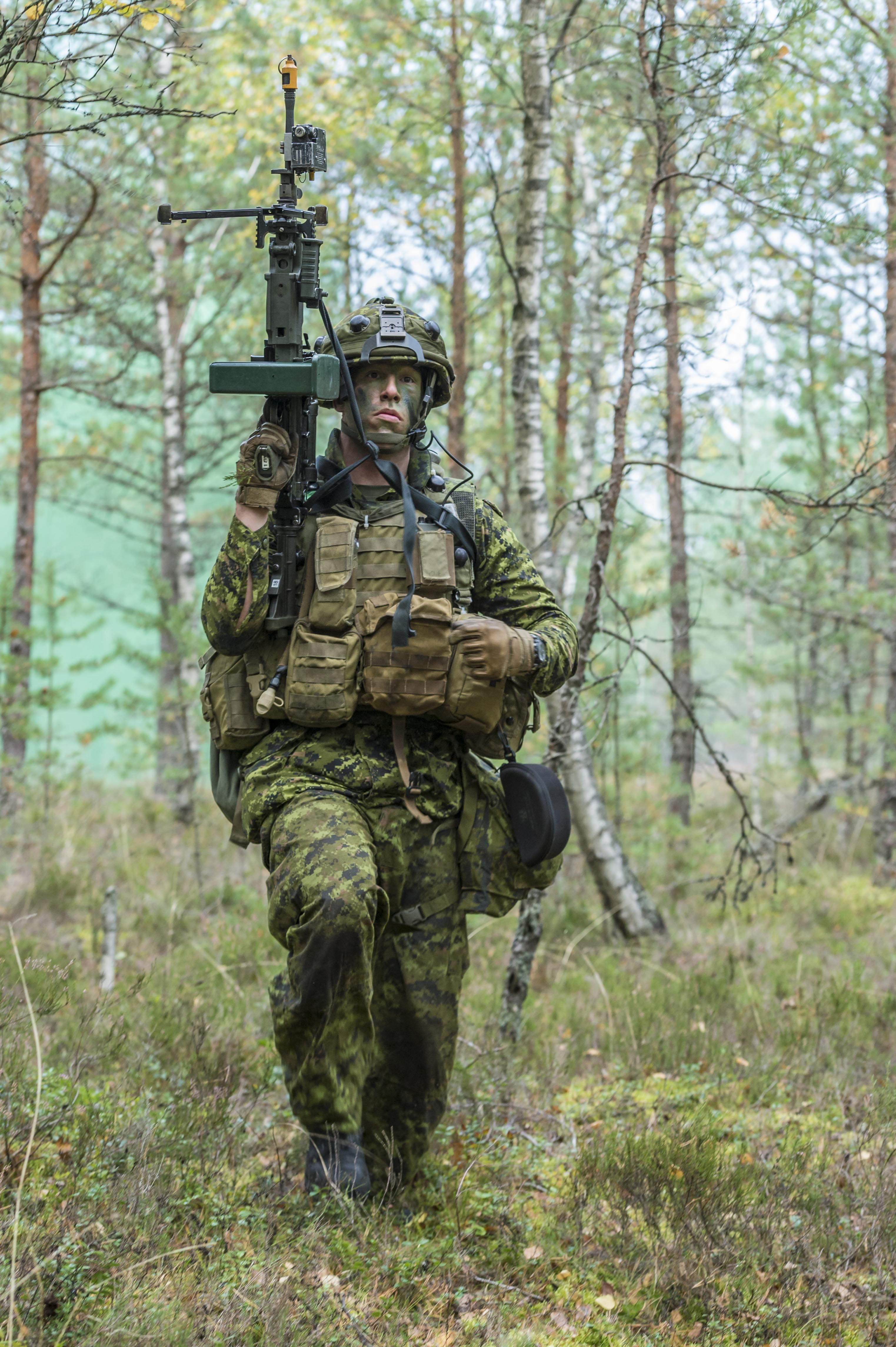 A Canadian soldier peeling back from an ambush during Exercise SILVER ARROW, Kadaga, Latvia on September 25, 2015