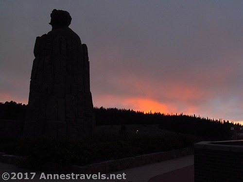 The sun sets behind the Lincoln Head at the Summit Rest Area / I-80 High Point between Cheyenne and Laramie, Wyoming