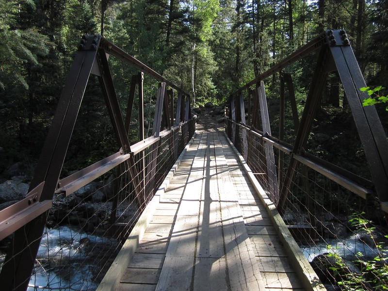 Steel bridge over Lake Creek on the Pine River Trail