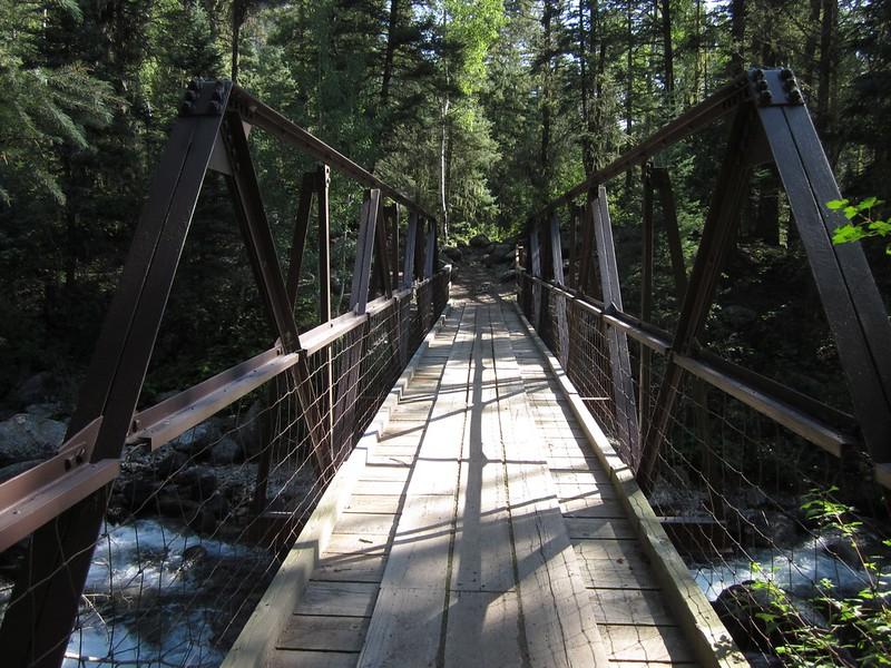Steel bridge over Lake Creek on the Pine River Trail