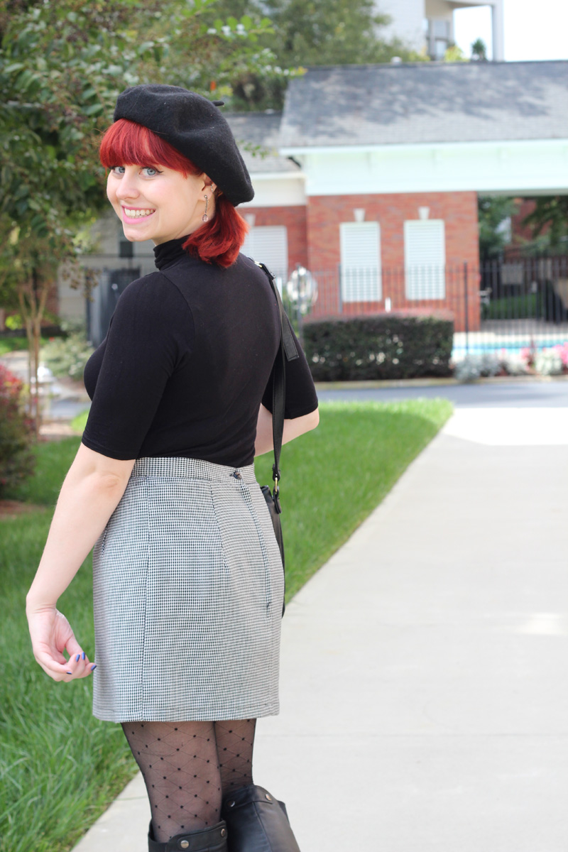 Black Beret, Red Ponytail, Black Turtleneck, and a Retro Tiny Houndstooth Skirt