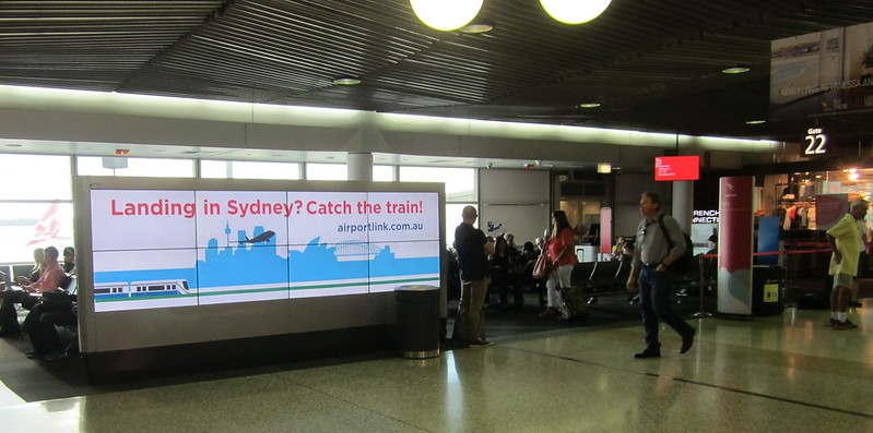 Sydney airport train ad at Brisbane airport