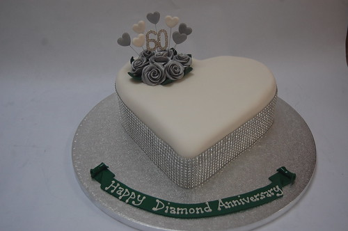 Simple and elegant with just a little bit of glitz and glamour! The Diamond Wedding Anniversary Cake - from £70.