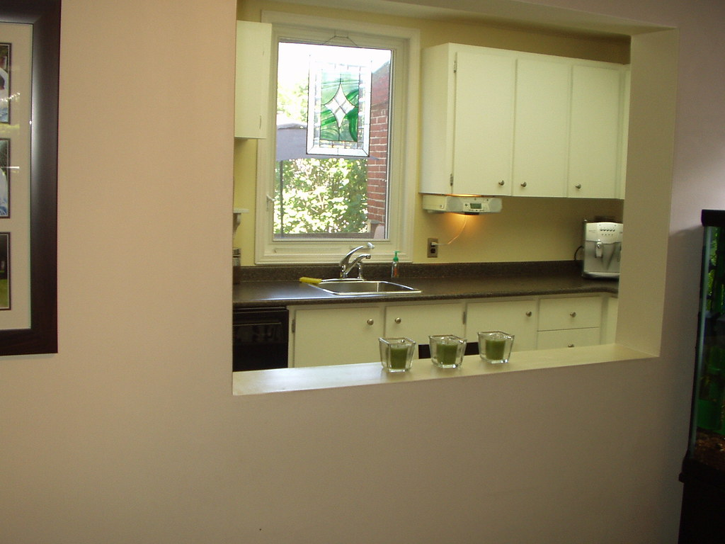 Looking into kitchen from dining room pass through window for Looking for kitchen