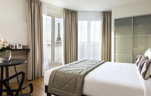Citadines Torre Eiffel. Habitación con vistas a la torre Eiffel, una maravilla