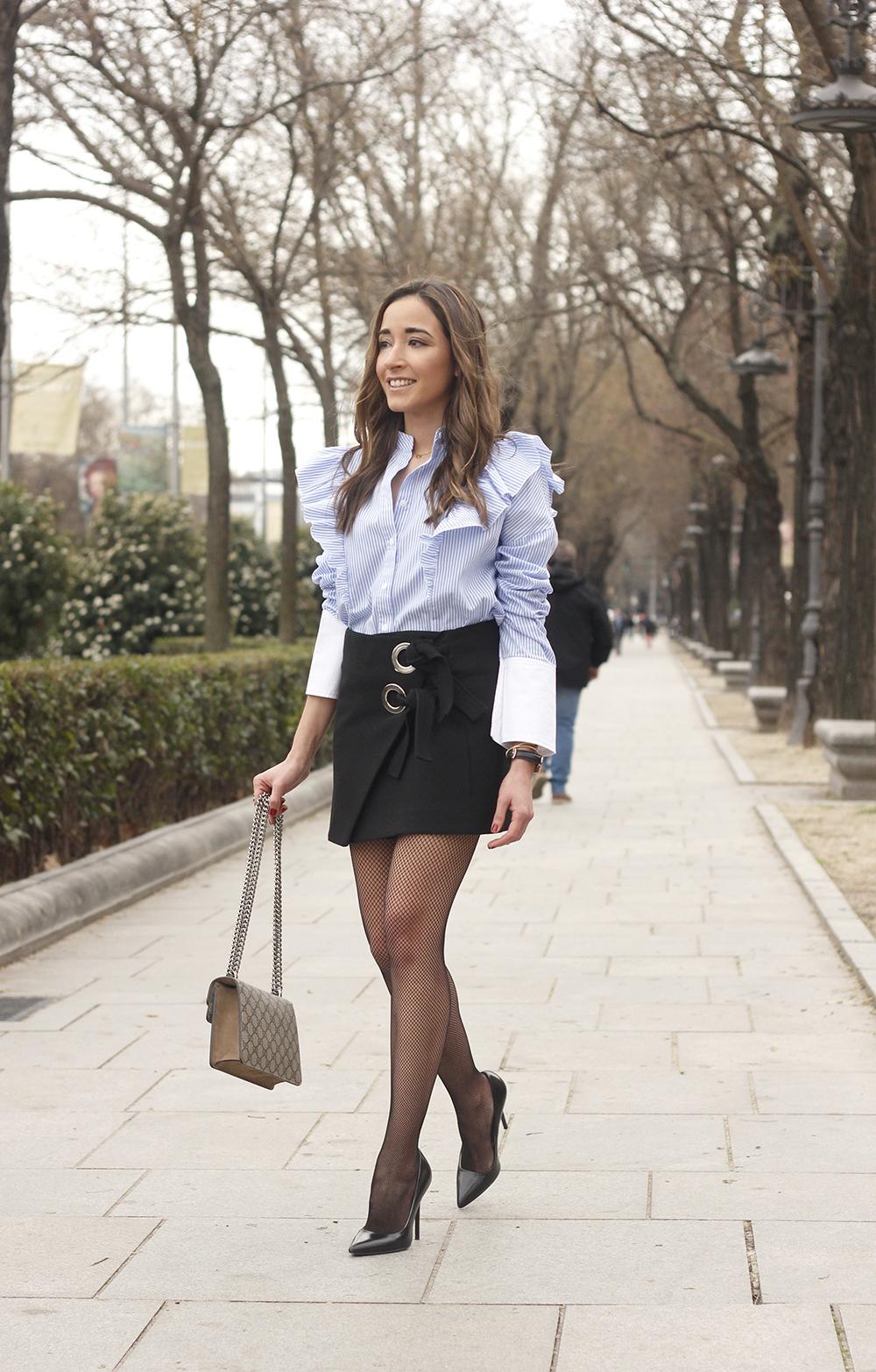 Ruffled striped shirt Fishnet tights black skirt heels gucci bag style fashion outfit 04