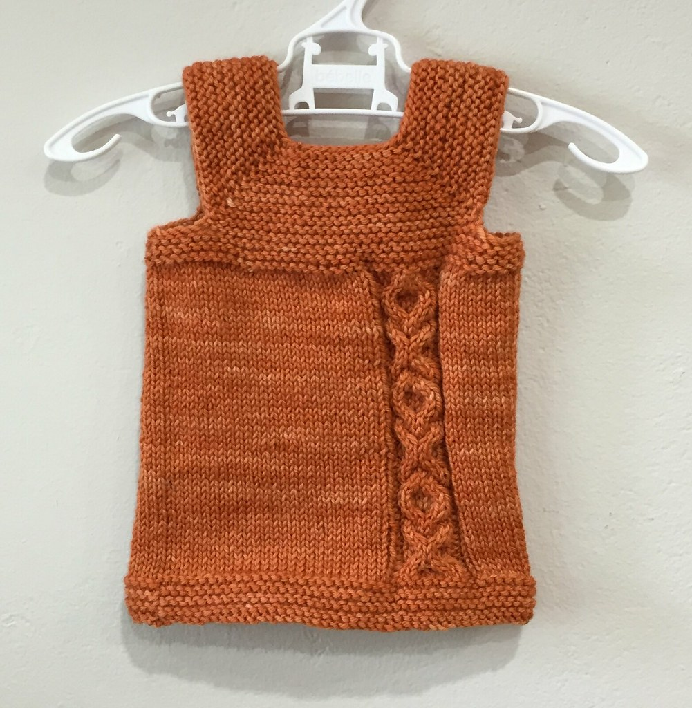 milo vest knitted in orange colinette cadenza