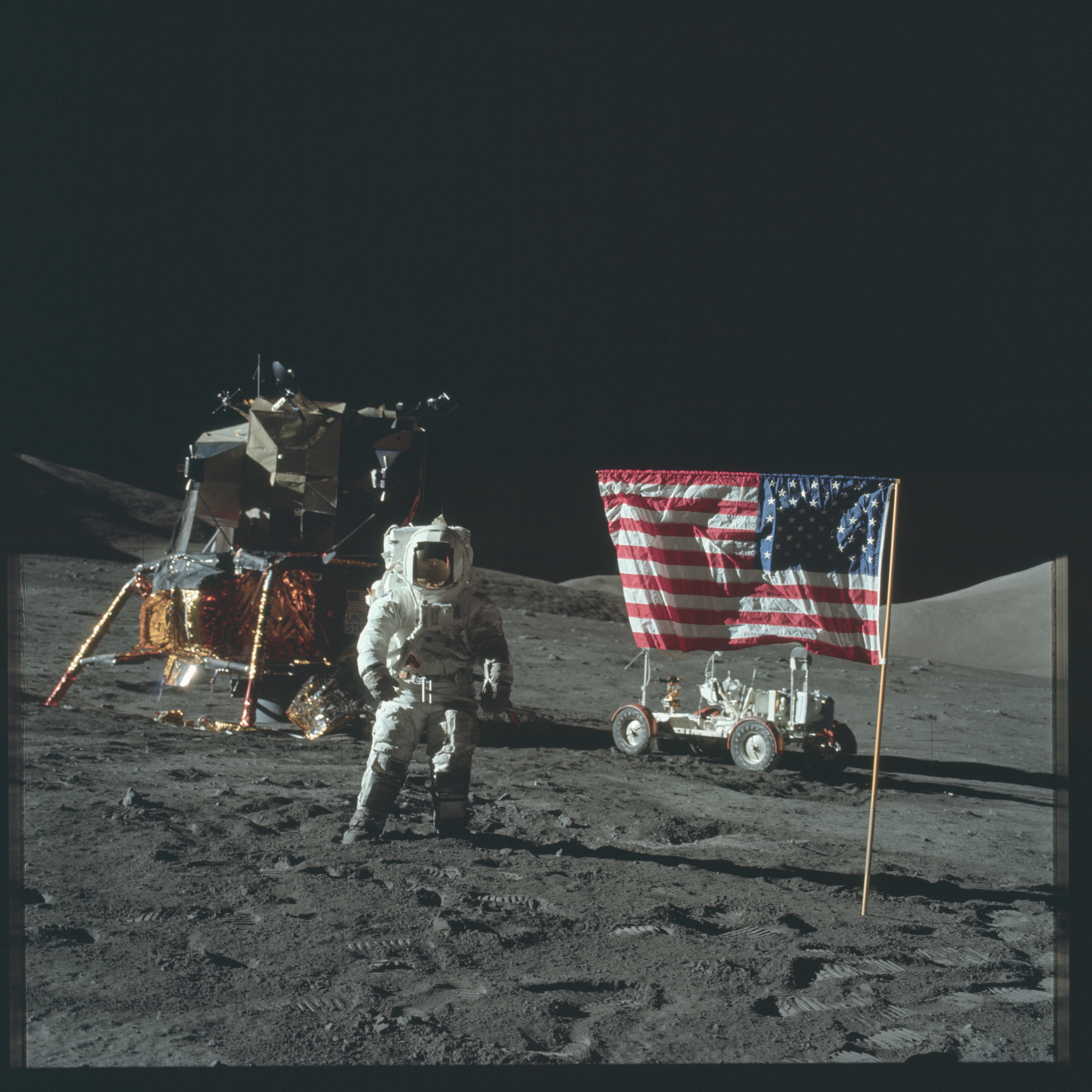 Astronaut Jack Schmitt poses with the American flag while ...