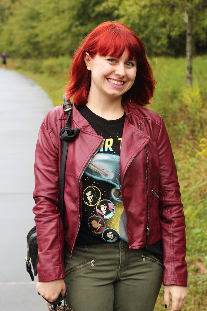 Bright Red Hair, Burgundy Faux Leather Jacket, and a Black Graphic T-shirt
