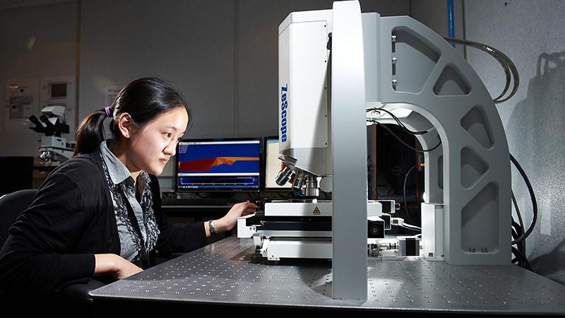 Melissa Leung operates a microscope