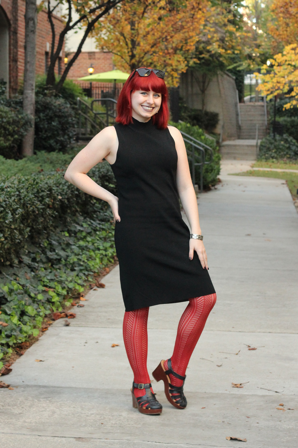 Black Mock Turtleneck Sleeveless Dress with Rust Orange Patterned Tights and Chunky Black Heels