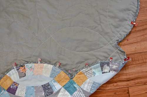 4. Using pins or magic binder clips, fold binding over quilt edge