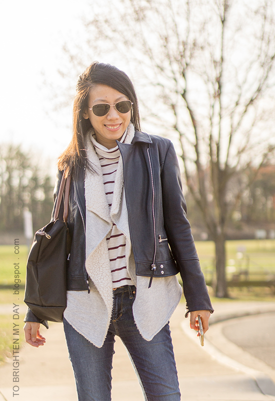black leather jacket, sherpa-lined open cardigan sweater, burgundy striped turtleneck, skinny jeans