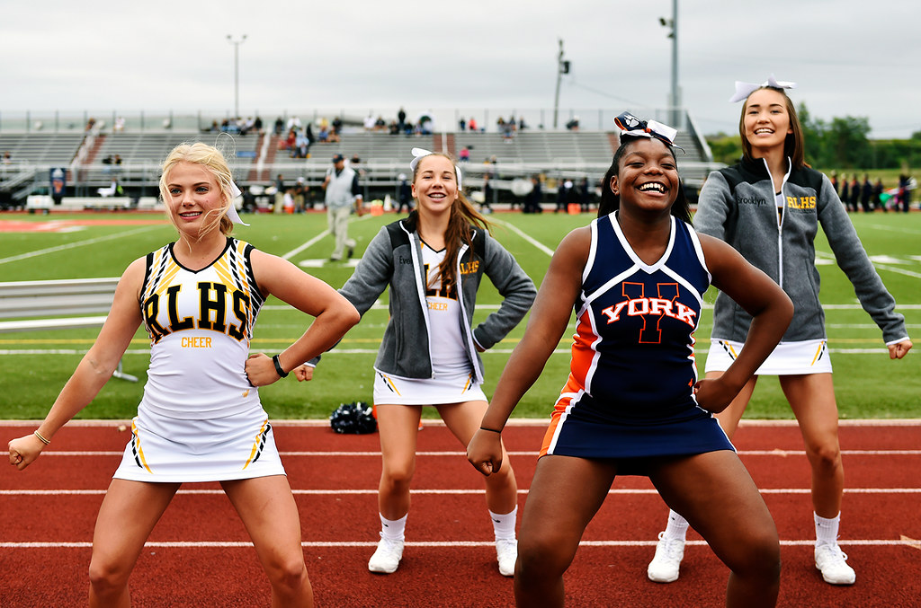 © 2016 by The York Daily Record/Sunday News. Red Lion cheerleaders -- including, from left, Olivia Riggs, Evelyn Adams and Brooklyn Bogdany -- join William Penn cheerleaders, including Darryanna Moore, second from right, in a cheer before a YAIAA football game Saturday, Sept. 24, 2016, at Small Field in York.
