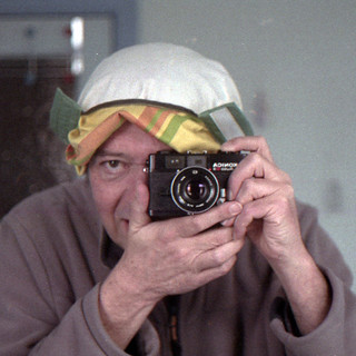 reflected self-portrait with Konica Auto S3 camera and inside out hat (square crop)