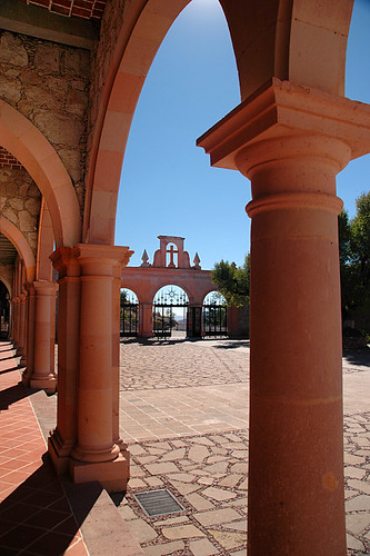 Pink stone arches and a cross over the gateway to the building atop the Bufa, the highest point in Zacatecas, Mexico