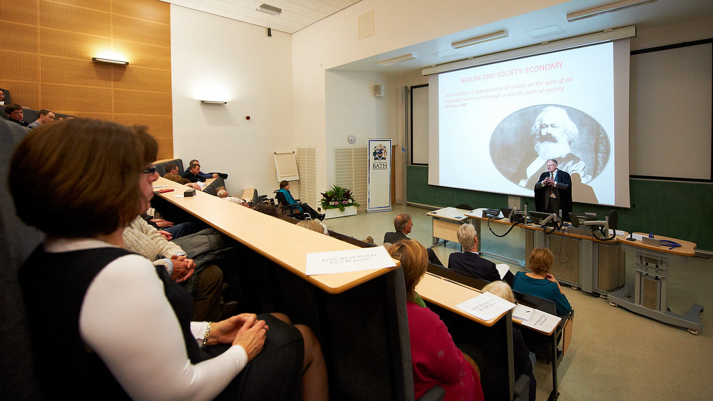 Attendees watching Stephen Gough present his inaugural lecture.
