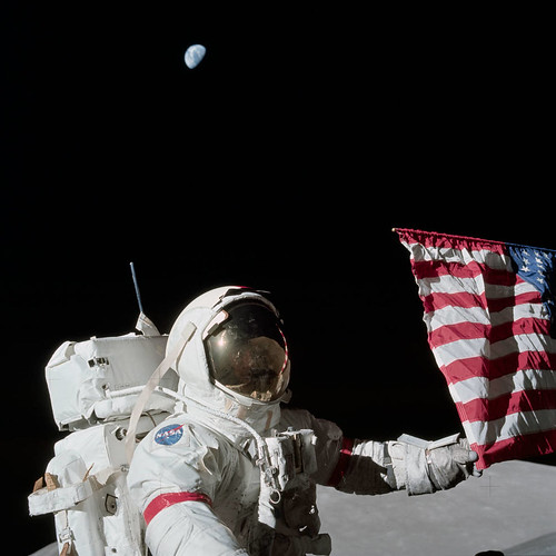 Apollo 17 Commander Eugene Cernan and the U.S. flag on the lunar surface.