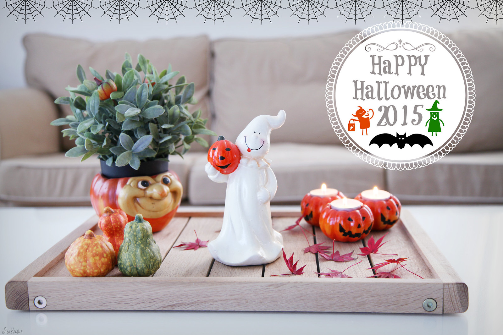 Halloween pumpkins ghost decoration coffee table tray living room area couch candle holders tea lights statue plant fake home indoor interior decor style
