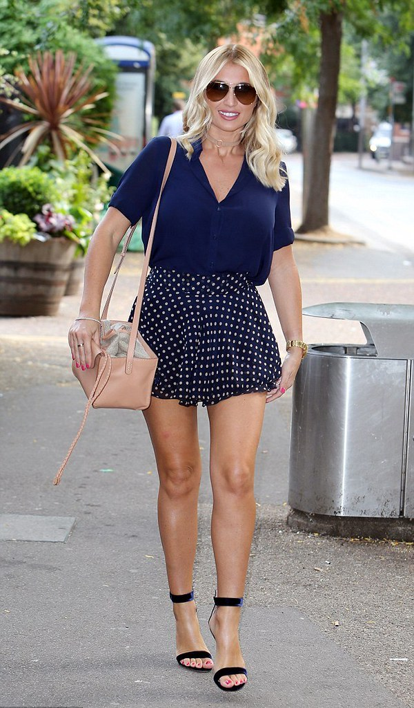 Polka dot skirt, navy blue blouse, a pair of  Gianvito Rossi navy velvet sandals, beige chocker with matching shoulder handbag and aviator shades.