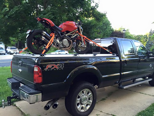 A Ford Superduty Hauls A Motorcycle On A Heavy Duty Alumin