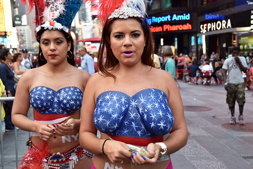 Women in times square in nyc wearing only body paint phot for Painting jobs nyc