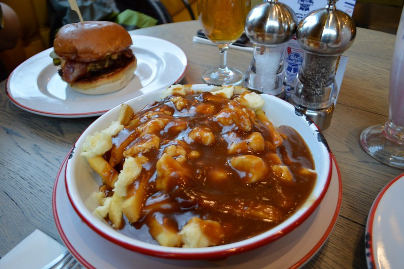 this is a picture of poutine, chips gravy and cheese curds