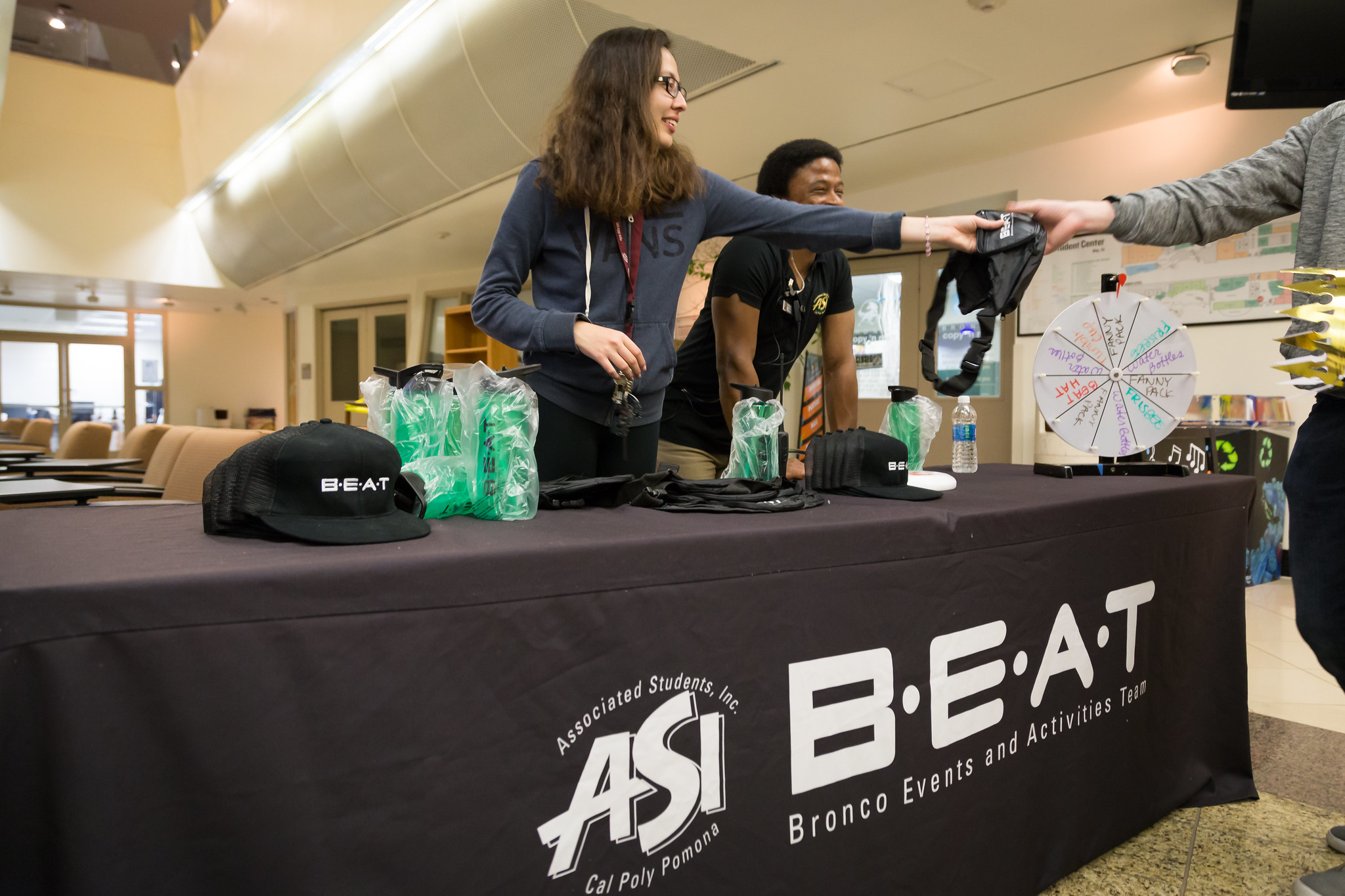 BEAT members hand out swag at an event