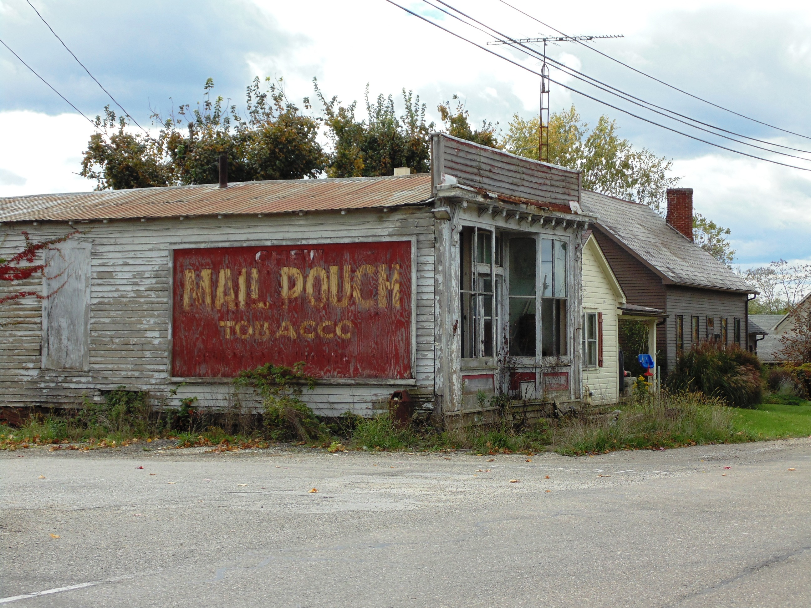 Mail Pouch Tobacco ghost sign on abandoned store - Claysville, Ohio U.S.A. - October 16, 2014