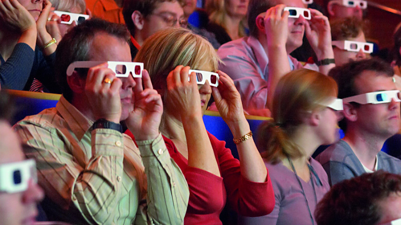 people with 3D glasses on their faces