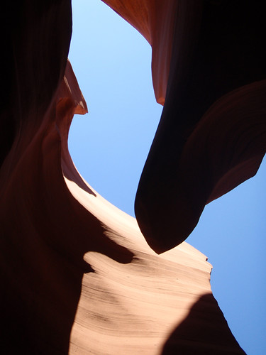 Lower Antelope Canyon, a slot canyon whose curving walls are formed by the rushing waters of a flash flood through the red sandstone located on Navajo lands east of Page, Arizona, USA