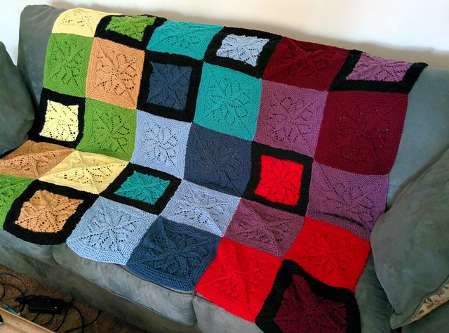 The patchwork blanket, laid out on my couch