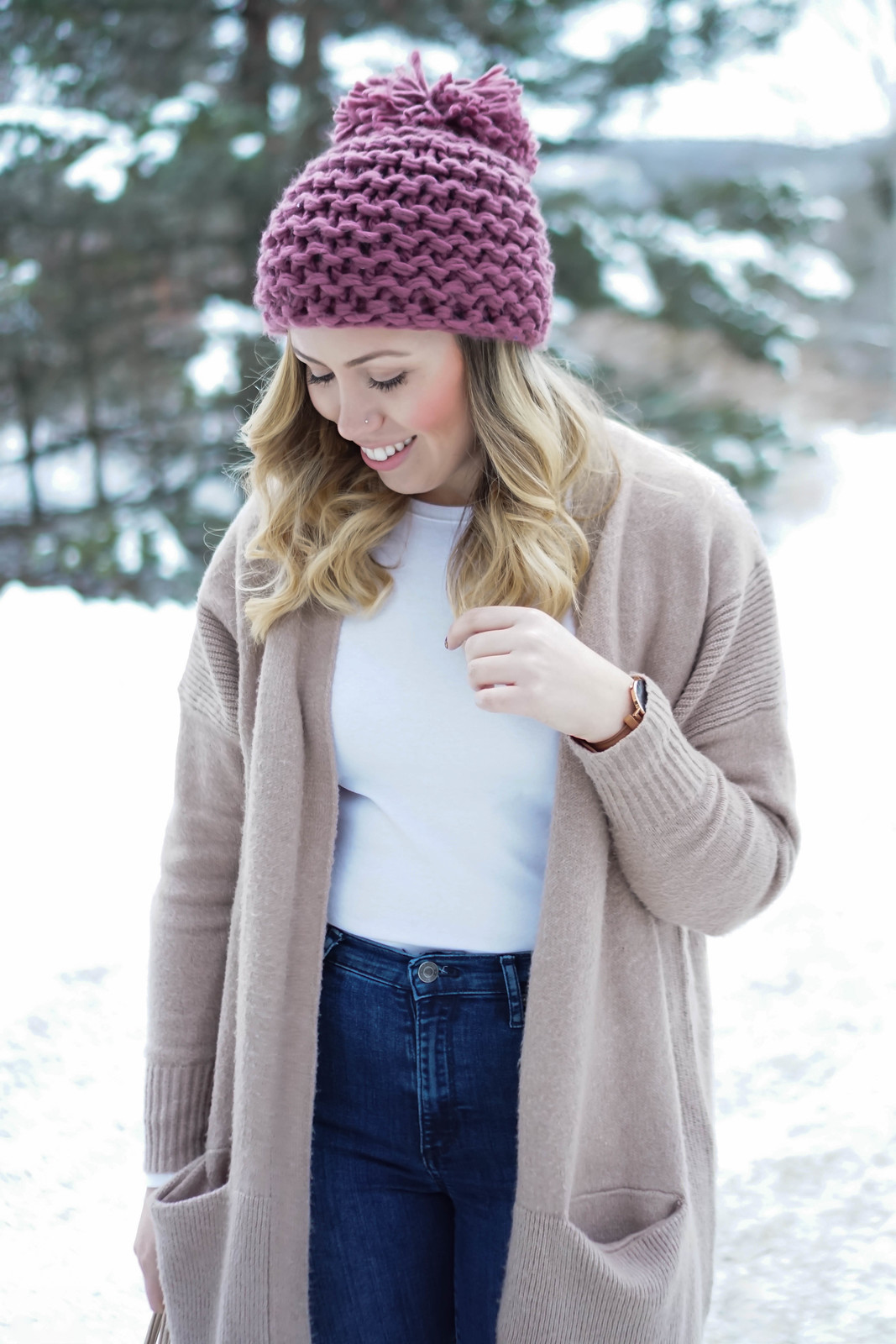 Casual Winter Pastel Outfit in Snow | Pink Pom Pom Beanie and Camel Oversized Sweater
