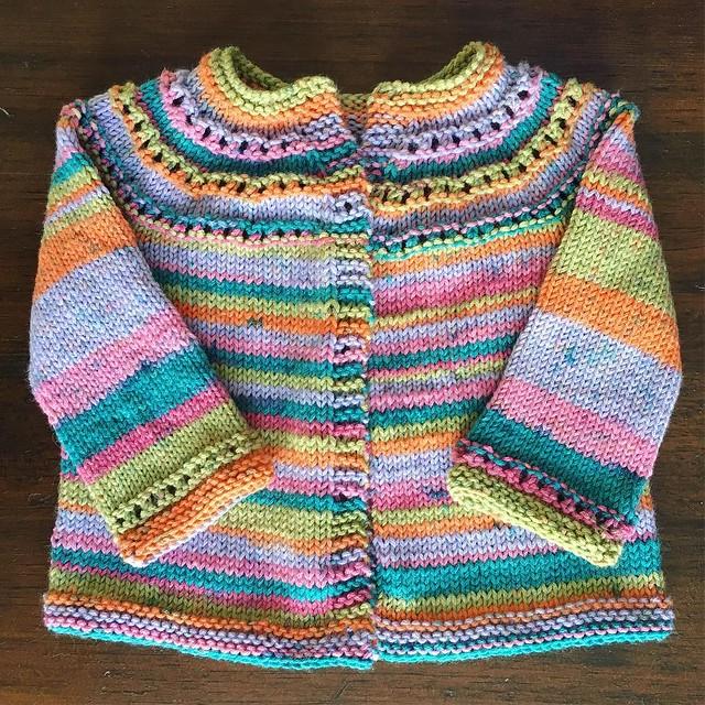 Little eyelet yoke cardigan off the needles. Just needs buttons. #knitting