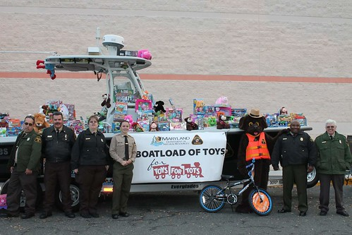 Photo of Maryland Natural Resources Police officers collecting a boatload of toys
