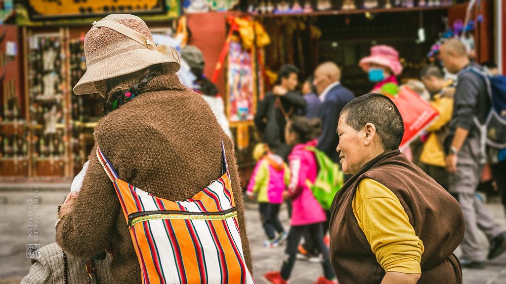 Tibet, candid shot of two walking in the market (Lhasa, China), 06-2016, 85 (Vlad Meytin, vladsm.com)