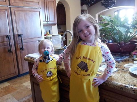 Josie and Noelle in aprons
