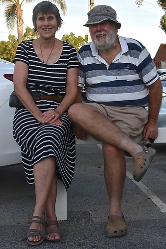 Jill and Paul Weaver sitting on a fence, 28 January 2017