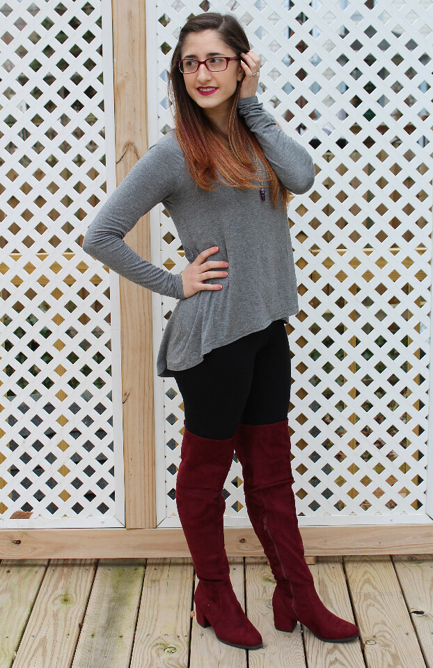Gray top and knee-high burgundy boots