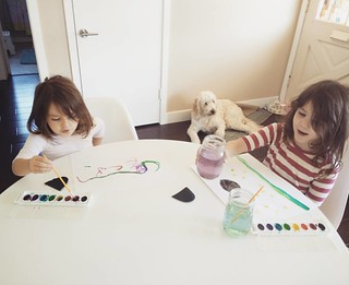 The girls love to paint in the morning while I'm making breakfast (today it was freshly baked cinnamon rolls). Pajamas last night were their younger sister's 12-18 month onesies. Love our simple mornings at home together. #homeschooling #magicalchildhood | by Urthmama