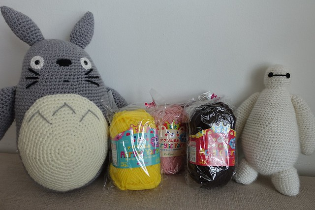 Totoro & Baymax Amigurumis posing with my Daiso yarns. The totoro is fully made with Daiso yarns.