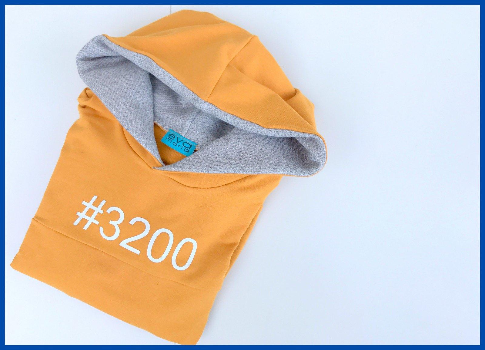 yellow hoodie (folded)