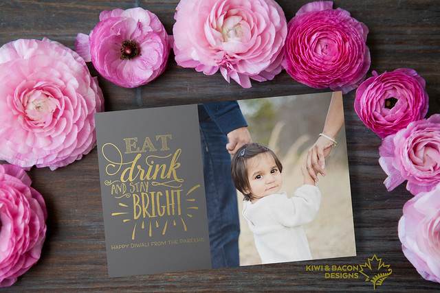 "Printable Diwali greeting card with a chalkboard style and gold foil image of ""Eat Drink and stay Bright""."