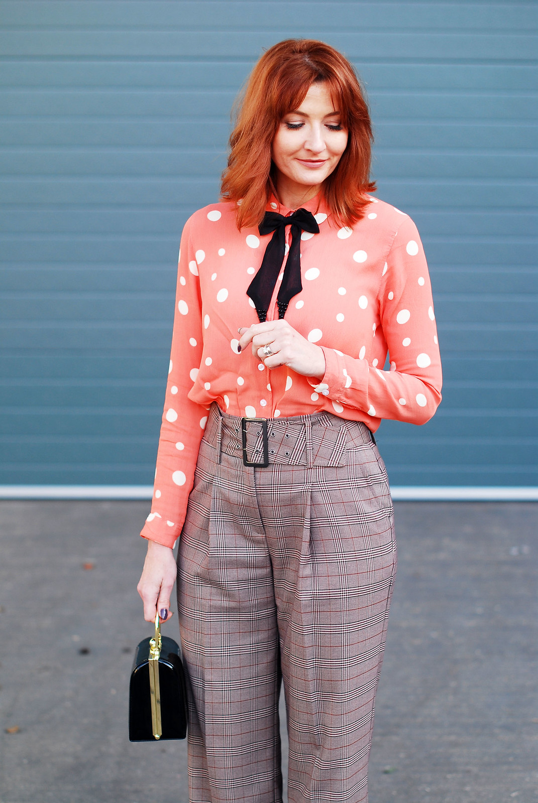 How to get the Katharine Hepburn look: Wide leg check turn up trousers masculine-cut black coat polka dot blouse with embellished black bow neck tie black box handbag cone-heeled black pointed shoes | Not Dressed As Lamb, over 40 style